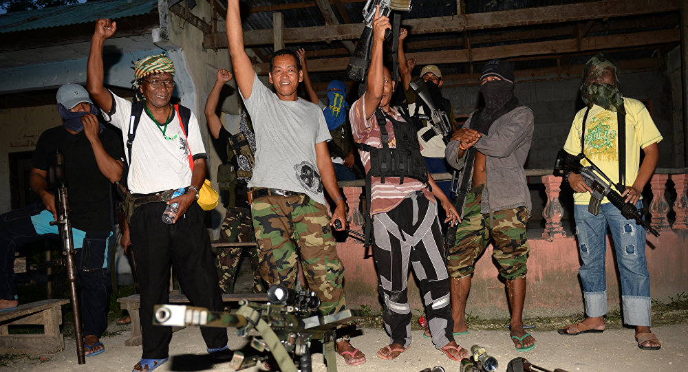 Abu Misry Mama (front L), spokesman of the Bangsamoro Islamic Freedom Fighters (BIFF) a splinter group of the Moro Islamic Liberation Front (MILF) that still wants independence, along with colleagues shout Allah Akbar (God is Great) after an interview with selected members of the media in Maguindanao, in southern island of Mindanao on March 28, 2014