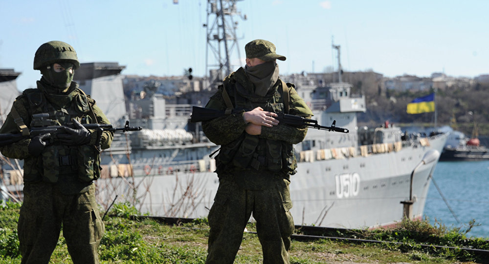Russian forces look out at the Ukrainian navy ship Slavutich in the harbor of the Ukrainian city of Sevastopol on March 5, 2014