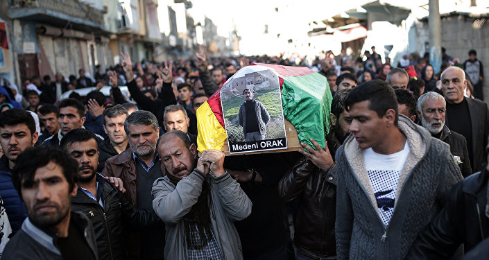 People carry the coffin of Medeni Orak, a man killed in Nusaybin, Turkey, Thursday, Dec. 24, 2015.