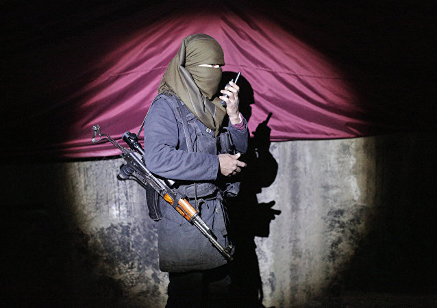 A militant of the Kurdistan Workers' Party, or PKK, stands at a barricade in Sirnak, Turkey, late Wednesday, Dec. 23, 2015.