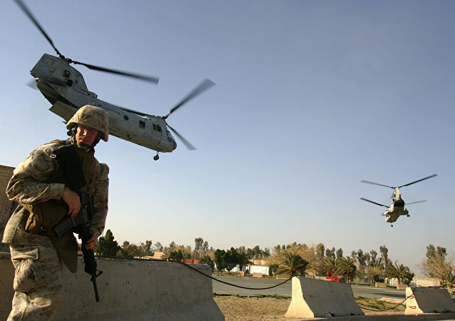 US marine ducks as CH-46 Sea Knight helicopters take off from Ramadi (File)