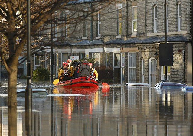 Emergency services navigate a flooded street in York, northern England, December 27, 2015