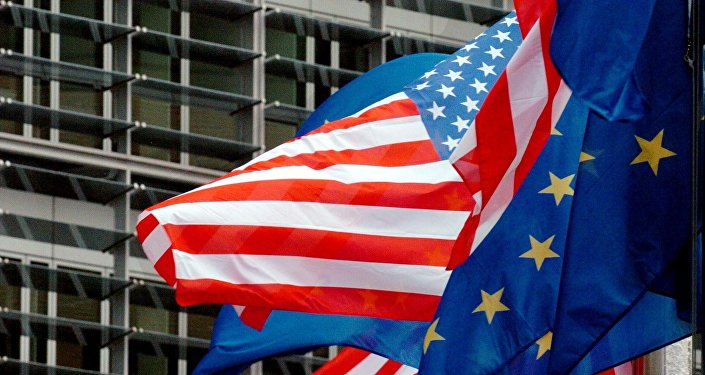 US and European flags float in front of the European Commission headquarters in Brussels 22 February 2005