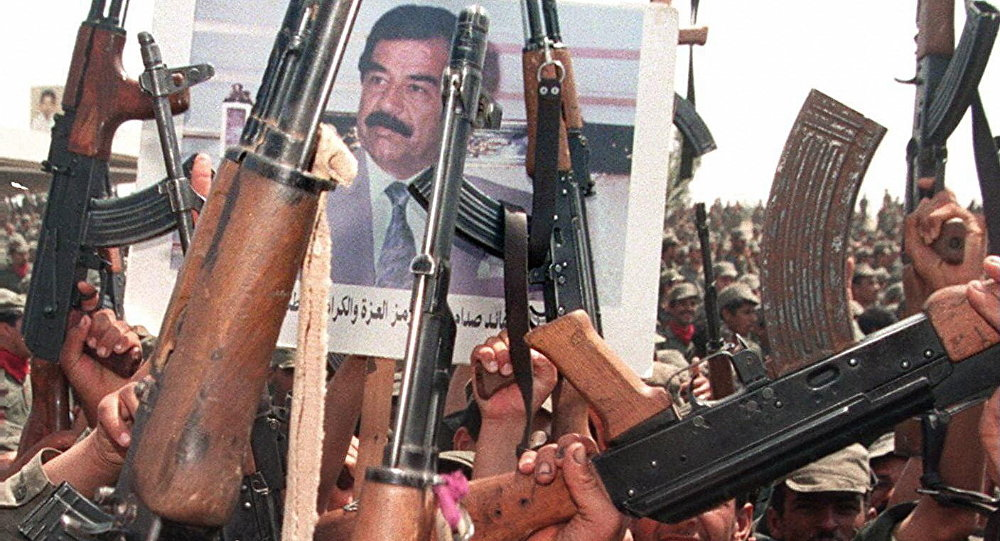 Iraqi soldiers hold up their arms during celebrations to mark the 61st birthday of Iraqi President Saddam Hussein 28 April 1998, in his home town of Tikrit, north of Baghdad