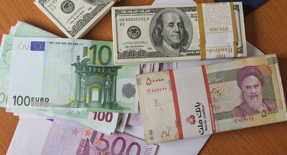 Euro and United States 100-dollar banknotes and Iran's rial banknotes