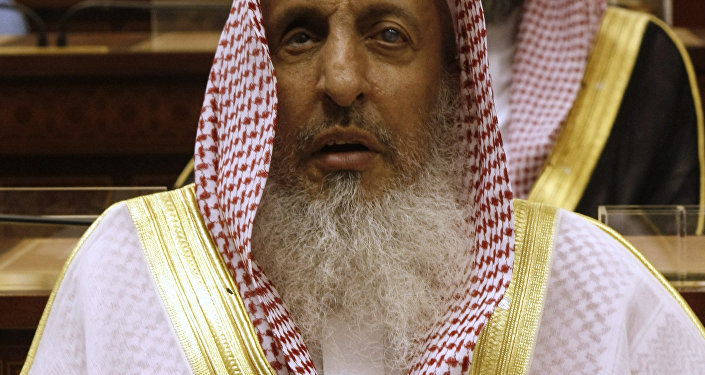 Sheikh Abdul Aziz al-Sheikh, the Saudi grand mufti listens to a speech of King Abdullah of Saudi Arabia at the Consultative Council in Riyadh, Saudi Arabia, Tuesday, March 24, 2009.