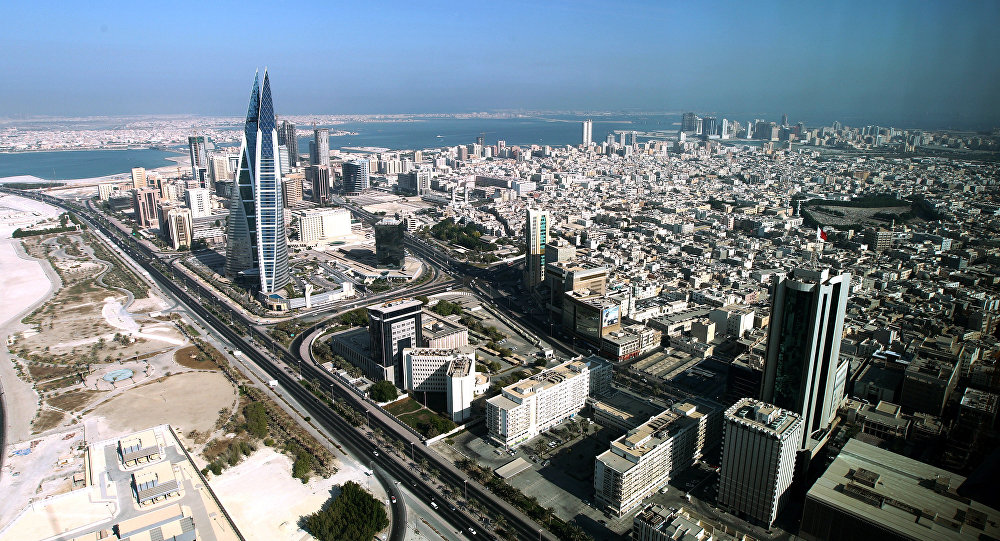 A picture taken through a window shows a general view of Bahrain's captial Manama and nearby cities on October 22, 2010