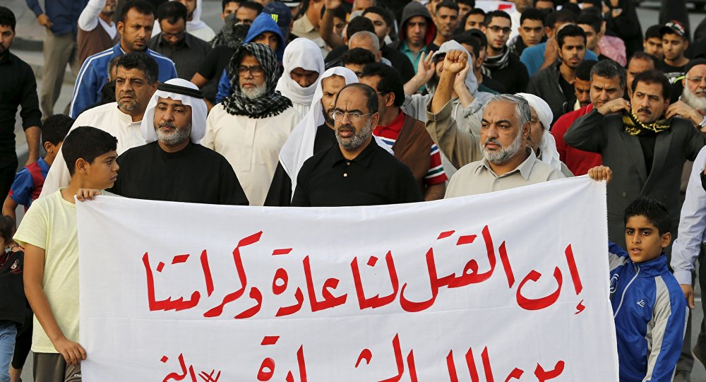 Protesters holding a banner saying Death is normal to us and our dignity from God is martyrdom take part in a protest against the execution of Saudi Shi'ite cleric Nimr al-Nimr by Saudi authorities, in the village of Sanabis, west of Manama, Bahrain January 2, 2016
