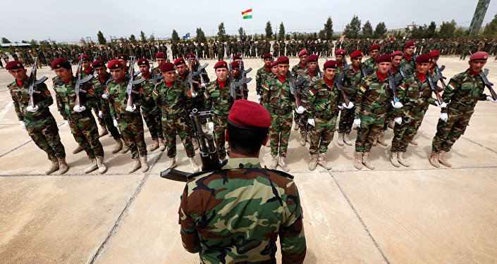 Kurdish Peshmerga fighters take part in a graduation ceremony on April 16, 2015 at the Kurdistan Training Coordination Center (KTTC) of Arbil, the capital of the autonomous Kurdish region of northern Iraq.