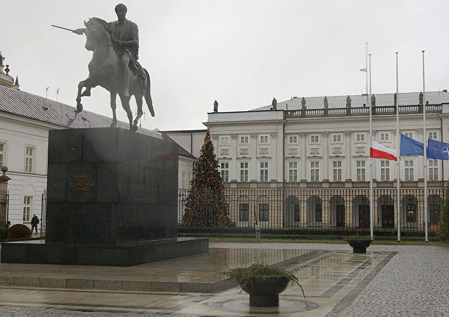 Poland's , European Union and NATO flags are lowered to half staff in front of the Presidential Palace in Warsaw, Poland