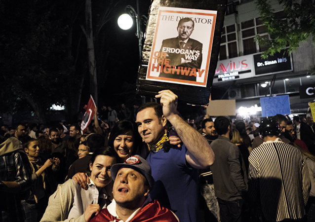 A mock magazine cover displaying Turkish Prime Minister Recep Tayyip Erdogan as Adolf Hitler is shown as thousands gather in central Ankara on June 6, 2013 for a demonstration against the Islamic-rooted government of Erdogan