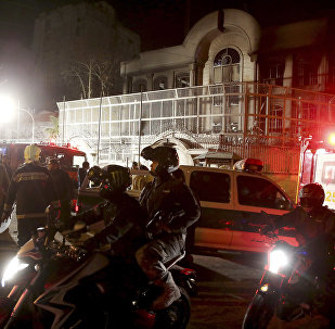 Iranian security protect Saudi Arabia's embassy in Tehran, Iran, while a group of demonstrators gathered to protest execution of a Shiite cleric in Saudi Arabia, Sunday, Jan. 3, 2016
