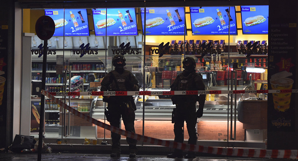 Police officers are seen guarding the entrance to the closed central station in Munich on January 1, 2016