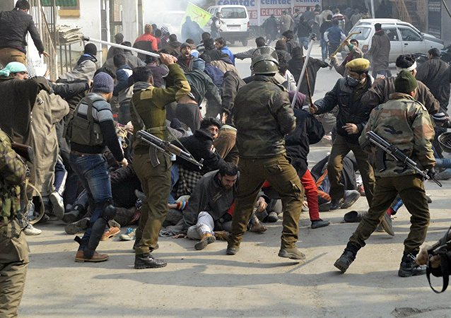 Indian police officers wield their batons against Kashmiri Shi'ite Muslims during a protest against the execution of cleric Nimr al-Nimr, who was executed along with others in Saudi Arabia, in Srinagar January 3, 2016