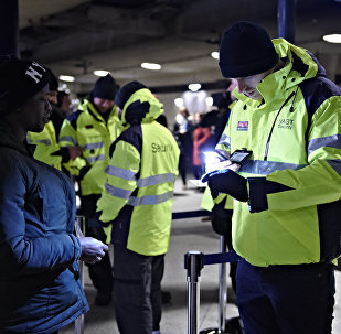 A passenger has her ID checked at the train station Copenhagen International Airport in Kastrup to prevent illegal migrants entering Sweden on Monday Jan. 4, 2016