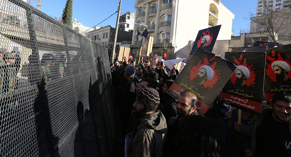 Iranian riot police block a street leading to the Saudi embassy as protesters hold portraits of prominent Shiite Muslim cleric Nimr al-Nimr during a demonstration against his execution by Saudi authorities, on January 3, 2016, in Tehran