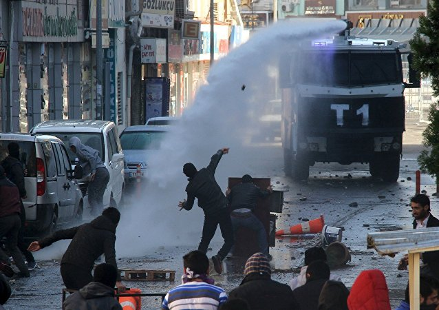 Riot police use a water cannon to disperse stone throwing Kurdish demonstrators during a protest against the curfew in Sur district, in the southeastern city of Diyarbakir, Turkey, December 22, 2015