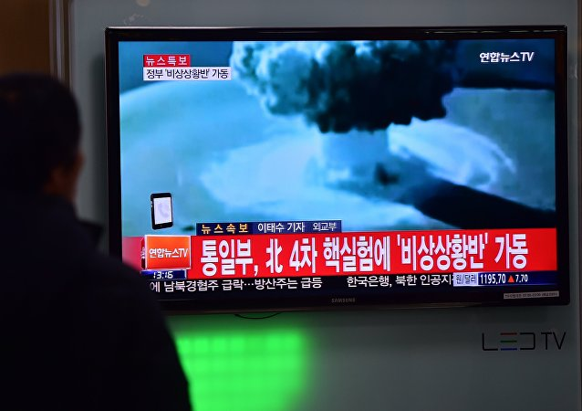 People watch a news report on North Korea's first hydrogen bomb test at a railroad station in Seoul on January 6, 2016