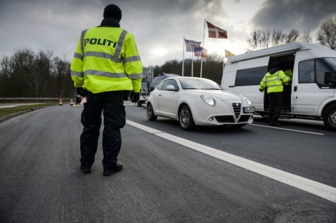 Danish Police officers check vehicles at the bordertown of Krusa, Denmark.
