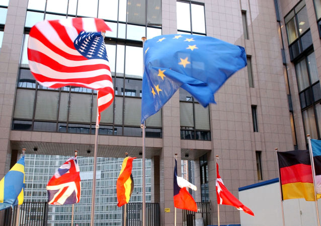 The US and EU flags, top left and right, fly in separate directions at the European Council building in Brussels