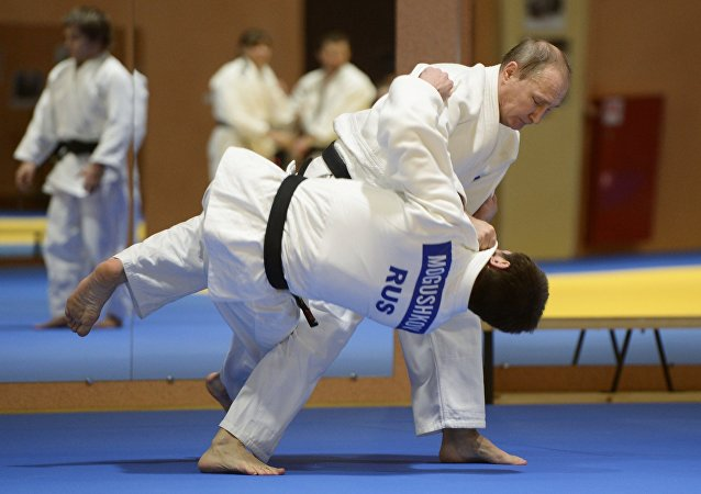 Russian President Vladimir Putin during a sparring with the 2014 World Judo Championship bronze medal winner Musa Mogushkov at the meeting with members of the Russian national judo team, January 8, 2016