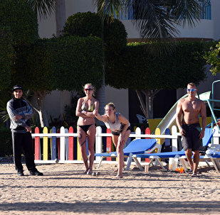 Tourists play bowels the beach at the Bella Vista Hotel in Egypt's Red Sea resort of Hurghada on January 9, 2016, the day after the hotel came under attack by knife-wielding assailants, in the latest blow to the country's beleaguered tourism industry