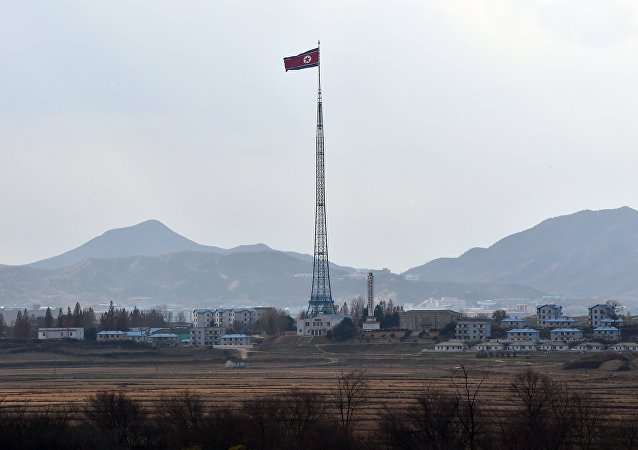 A North Korean flag flutters in the propaganda village of Gijungdong as seen from a South Korean military check point of the truce village of Panmunjom in the Demilitarized Zone dividing the two Koreas on November 12, 2014