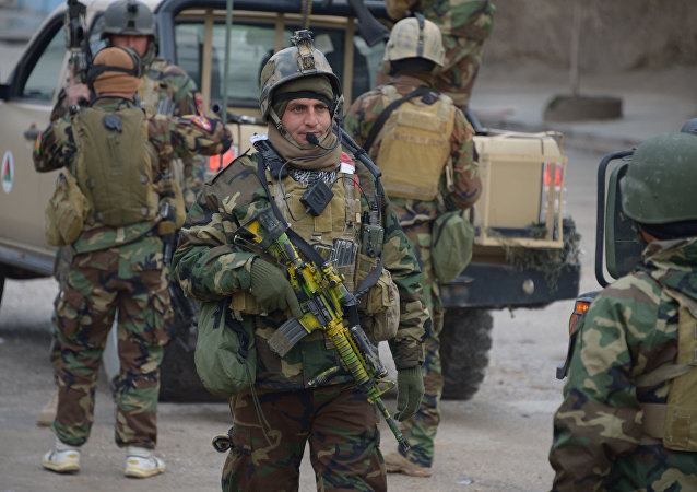 Afghan National Army (ANA) soldiers arrive for an operation near the Indian consulate in Mazar-i-Sharif on January 4, 2016