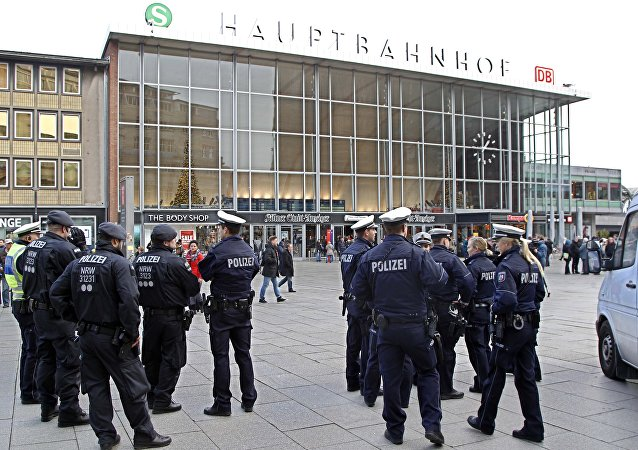 Police officers patrol in front of the main station of Cologne, Germany