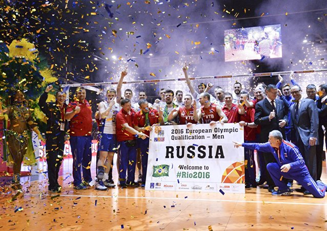 Coaches and athletes of the Russian national men's voleyball team after a victory in a final match of the men's qualification volleyball tournament for the 2016 Olympic Games between France and Russia