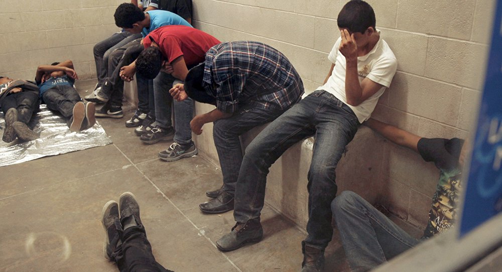 Immigrants who have been caught crossing the border illegally are housed inside the Border Patrol Station in McAllen.