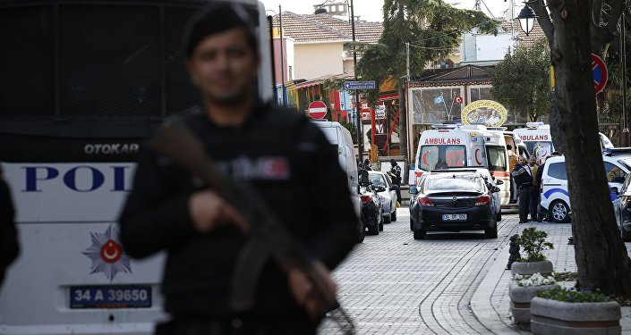Policemen secure the historic Sultanahmet district, which is popular with tourists, as ambulances arrive after an explosion in Istanbul, Tuesday, Jan. 12, 2016
