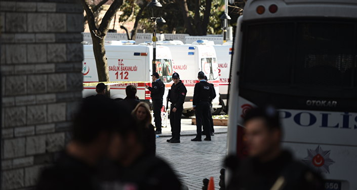 Turkish police stand next to ambulances as they block access to the Blue Mosque area on January 12, 2016 after a blast in Istanbul's tourist hub of Sultanahmet left 10 people dead