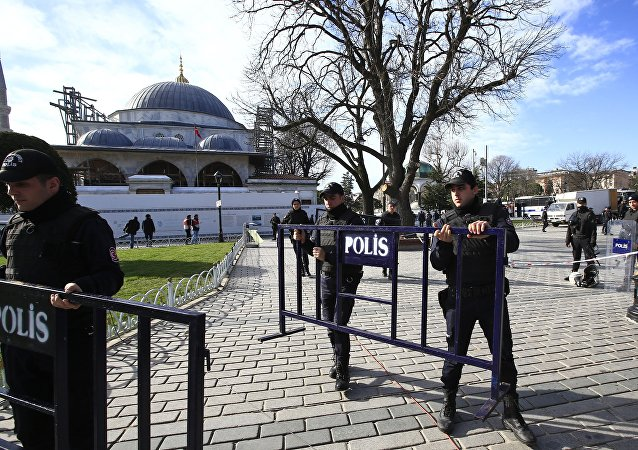 Police officers install security barriers at the historic Sultanahmet district, which is popular with tourists, after an explosion in Istanbul, Tuesday, Jan. 12, 2016