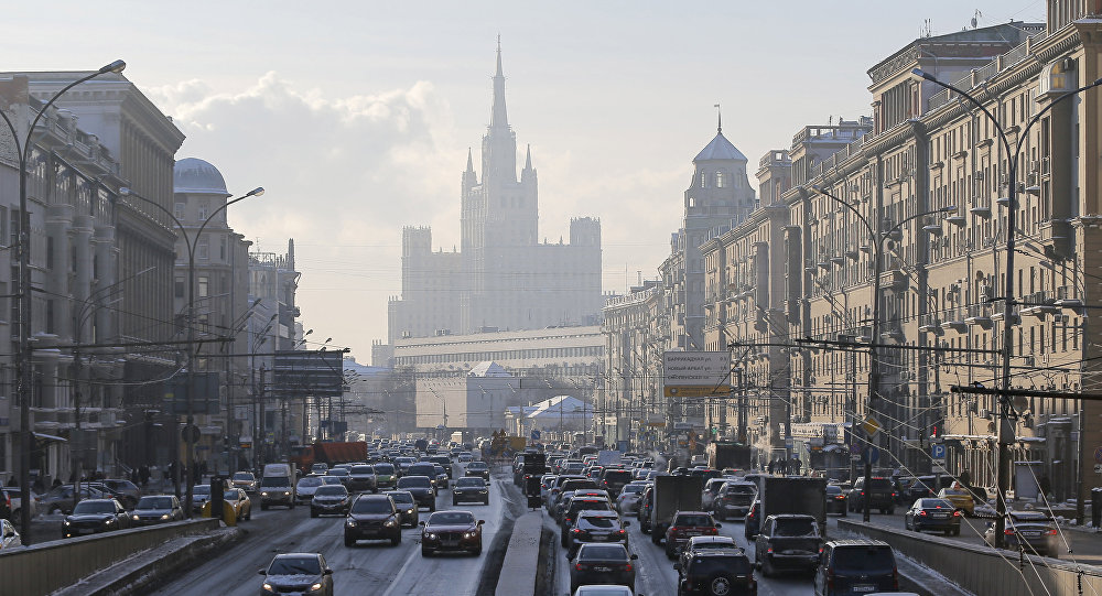 Cars drive along the Garden Ring road, with a residential building at Kudrinskaya Square seen on the background, in Moscow, Russia