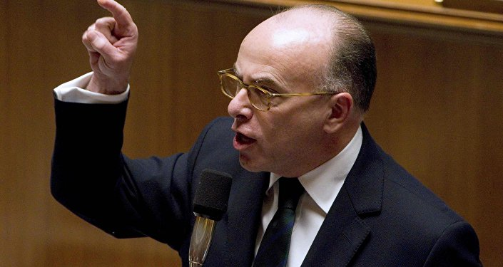 Bernard Cazeneuve replies to deputies during the questions to the government session at the National Assembly in Paris, France, January 12, 2016