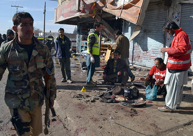 Pakistani police officers and rescue workers gather at the site of suicide bombing targeting a polio vaccination center in Quetta, Pakistan, on Wednesday, Jan. 13, 2016.