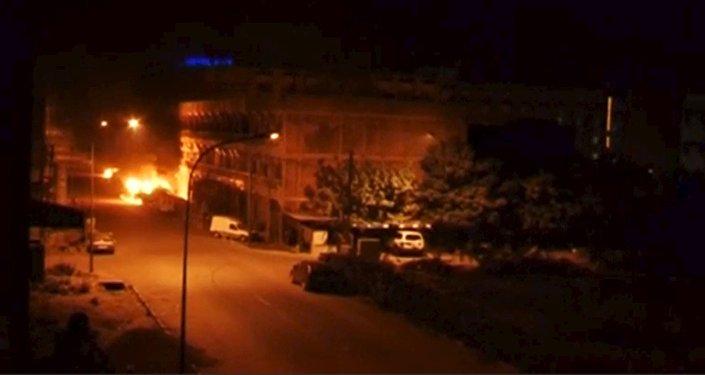A general view shows fire beneath Splendid Hotel in Ouagadougou