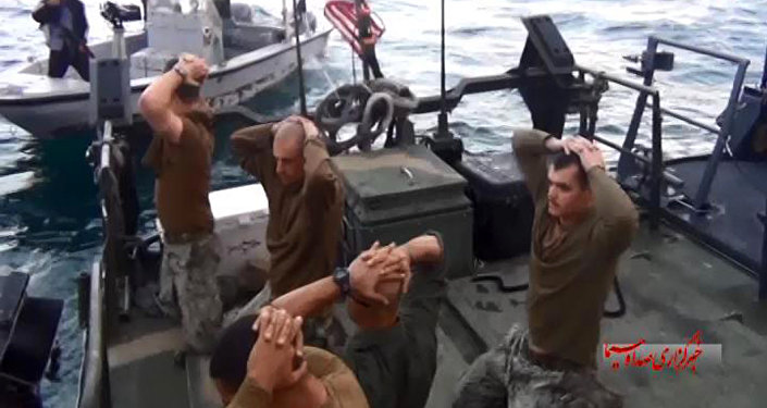 This frame grab from Tuesday, January 12, 2016 video by the Iranian state-run IRIB News Agency, shows detention of American Navy sailors by the Iranian Revolutionary Guards in the Persian Gulf, Iran