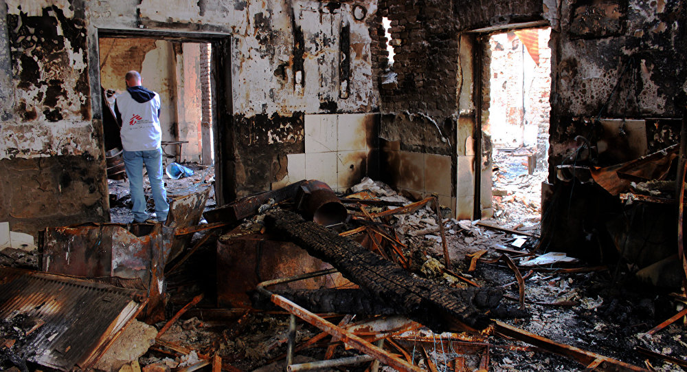 In this photograph taken on November 10 ,2015, Medecins Sans Frontieres (MSF) staff walk in the damaged Medecins Sans Frontieres (MSF) hospital in northern Kunduz