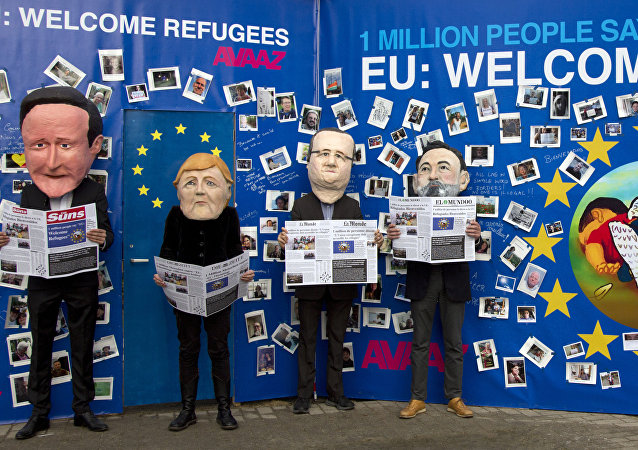 Actors dressed in EU leader face masks pose in front of a refugee message board during a demonstration in front a refugee message board outside of EU headquarters on Monday, Sept. 14, 2015.