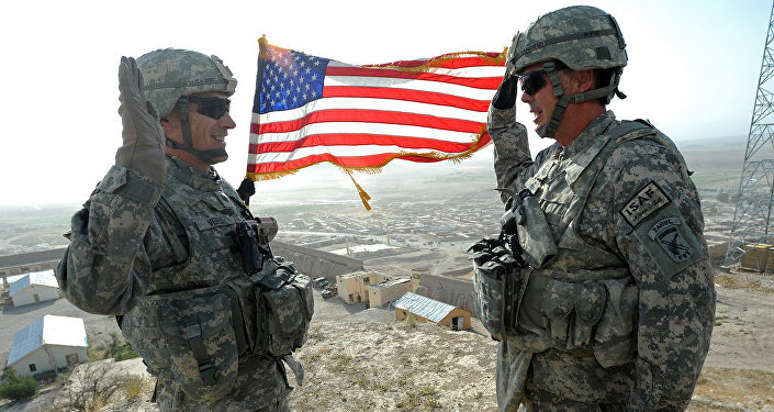U.S. Air Force Lt. Col. Andy Veres, left, Provincial Reconstruction Team Zabul commander, re-enlists Master Sgt. James Sandifer, Forward Operating Base Smart mayor, on top of Alexander's castle in Qalat City, Afghanistan, July 7
