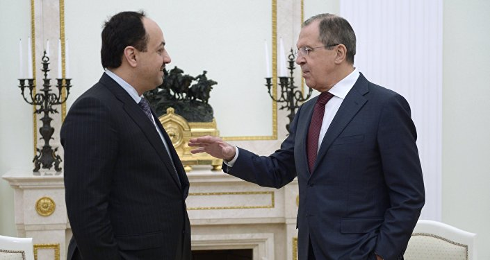Qatari Foreign Minister Khalid Bin Mohamed al-Attiyah (left) and his Russian counterpart Sergei Lavrov talking before President Vladimir Putin's Kremlin meeting with Qatari Emir Tamim bin Hamad Al-Thani, January 18, 2016