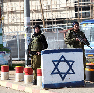Israeli soldiers stand guard at the Gush Etzion junction in the West Bank (File)