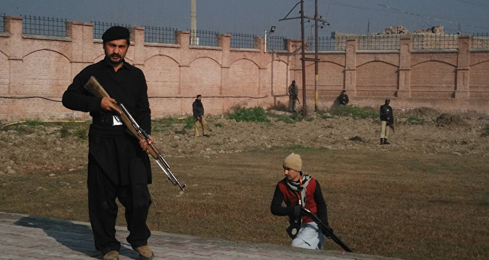 This photograph taken from a mobile phone shows Pakistani security personnel taking position outside the Bacha Khan university following an attack by gunmen in Charsadda, about 50 kilometres from Peshawar, on January 20, 2016