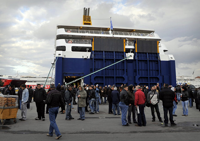 Sailors and strike supporters gather on April 10, 2012 in front of a ferry at the port of Piraeus as Greek sailors began a two-day strike against government reforms