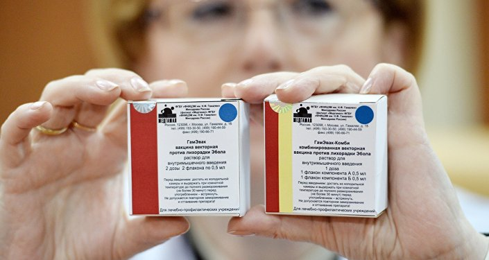 Russian Healthcare Minister Veronika Skvortsova demostrates Anti-Ebola fever vaccine packages at Gamalei Research Institute of Epidemiology and Microbiology