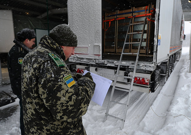 Ukrainian border control officers inspecting a Russian truck in Donbass. File photo.