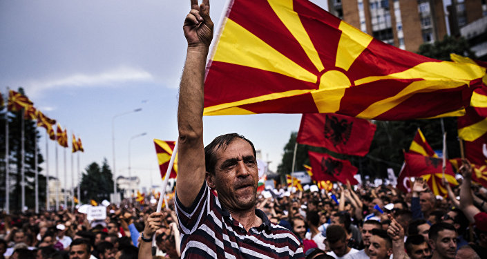 A man flahes the V-sign for victory during an anti-government protest in downtown Skopje on May 17, 2015