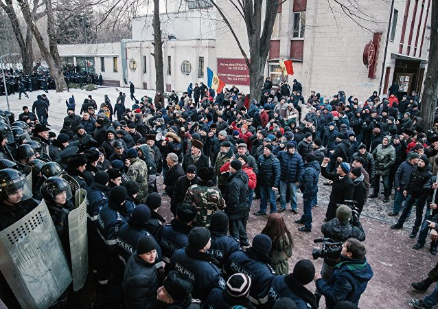 Protests outside Moldovan parliament building in Chisinau.